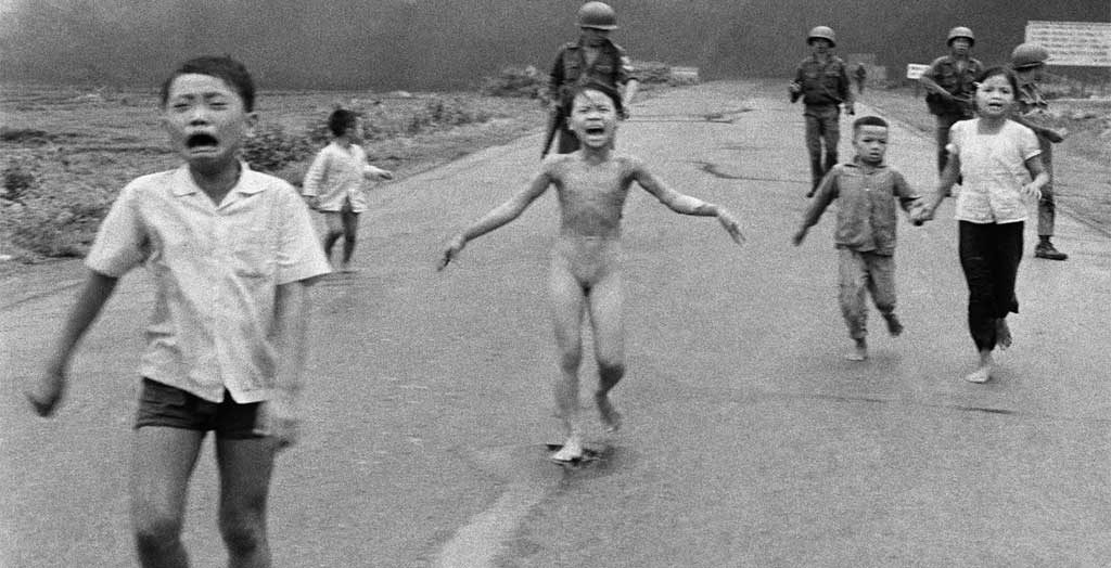 South Vietnamese forces follow after terrified children, including 9-year-old Kim Phuc, center, as they run down Route 1 near Trang Bang after an aerial napalm attack on suspected Viet Cong hiding places on June 8, 1972. Photo: Nick Ut / AP / Polfoto