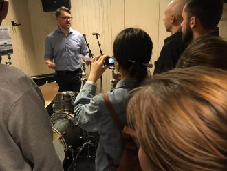 Tvibit manager Christian Hyld in the back showing one of Tvibit's numerous rehersal rooms. Robota 2018 Journos taking notes. Tvibit is recently rebuilt for 107 million kroner. Foto: Ole Rode
