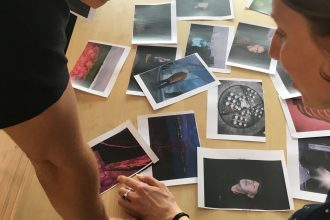 The participants are working with small prints.